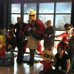 Me and other bloggers posing in front of the Incredibles statues at Pixar