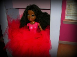 One of the dolls they don't play with anymore. She just dressed her up with a tu-tu!
